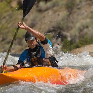 Man in Orange River Runner Kayak